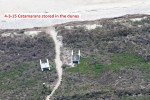 2950---4-3-15 Catamarans plus tie down poles in dunes